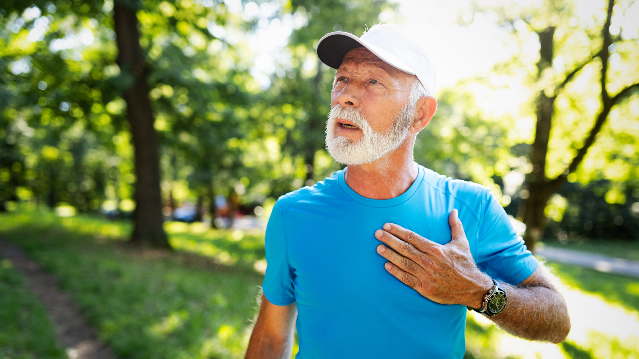 man in running outfit clutching chest