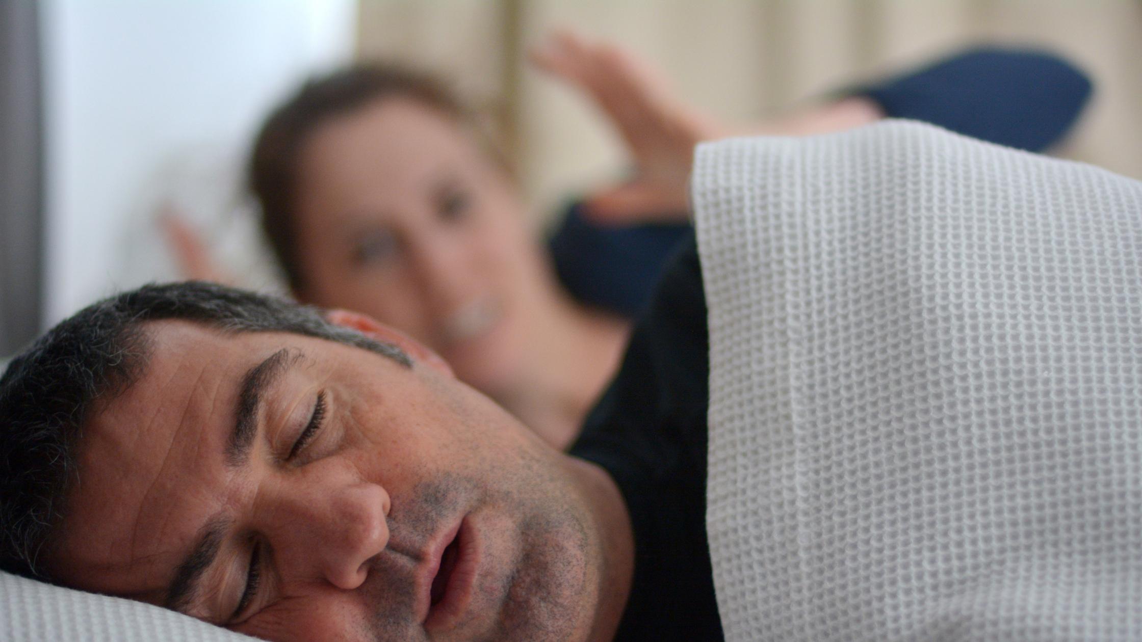 man snoring keeping partner awake